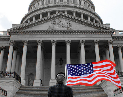 USCapitolFlagProtester-Attrib-Flickr-TheQSpeaks-4456188446