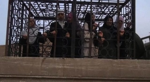 US-backed Syrian Rebels use women in cages as human shields