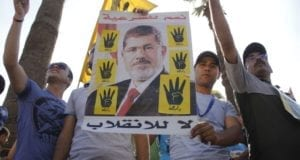 Protesters with poster of ousted Egyptian President Morsi in Maadi Cairo Sep 2013