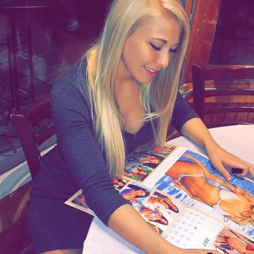 Miranda Richmond, the accuser of late Kentucky Rep. Dan Johnson, signing a calendar for which she posed in 2011 in a photo on a now closed Twitter account.