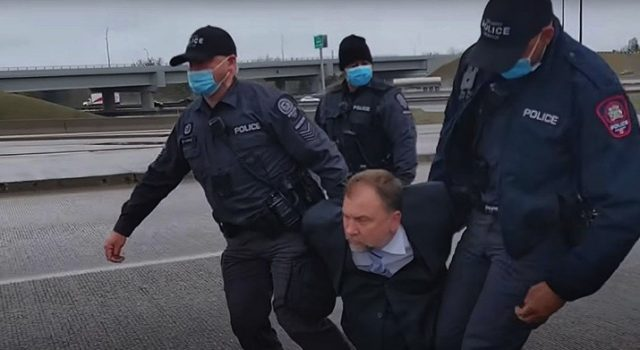 Video of the arrest Saturday was shared to YouTube. (Artur Pawlowski TV)